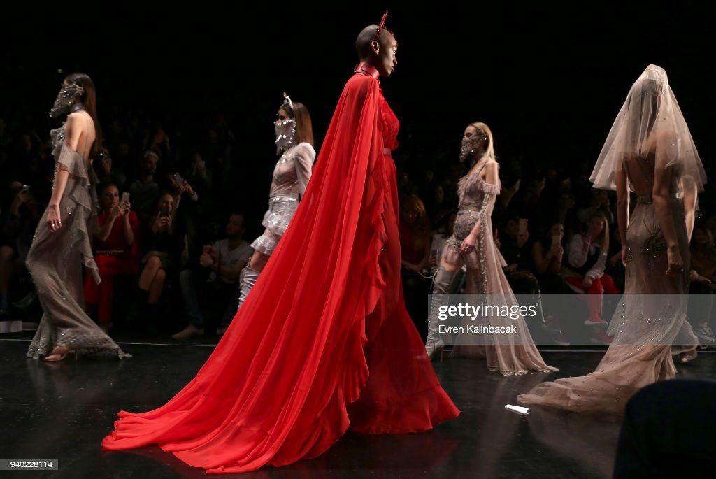 Models walk the runway at the Zeynep Tosun show during Mercedes Benz Fashion Week Istanbul at Zorlu Performance Hall on March 30, 2018 in Istanbul, Turkey.