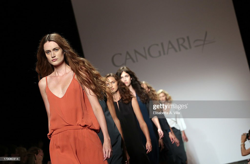 Models walk the runway during Cangiari S/S 2014 Haute Couture Handwoven eco-ethical colletion fashion show as part of AltaRoma AltaModa Fashion Week at Santo Spirito In Sassia on July 6, 2013 in Rome, Italy.