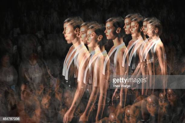 Models walk the runway during Carmen Marc Valvo show at Mercedes-Benz Fashion Week Fall 2014 on September 5, 2014 in New York City.