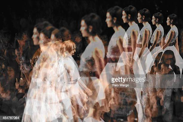 Models walk the runway during Carmen Marc Valvo show at MercedesBenz Fashion Week Fall 2014 on September 5 2014 in New York City