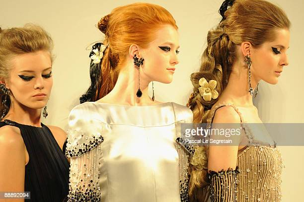 Models walk the runway during Chanel as part of Paris Fashion Week Haute Couture A/W 2009/10 at Grand Palais on July 7 2009 in Paris France