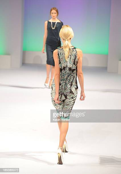 Models walk the runway during Elyse Walker Presents The Pink Party 2013 hosted by Anne Hathaway at Barker Hangar on October 19 2013 in Santa Monica...