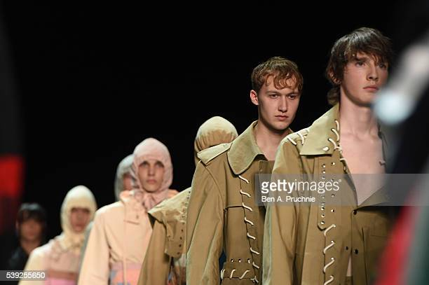 Models walk the runway during finale at the Craig Green show during The London Collections Men SS17 at Topman Show Space on June 10 2016 in London...