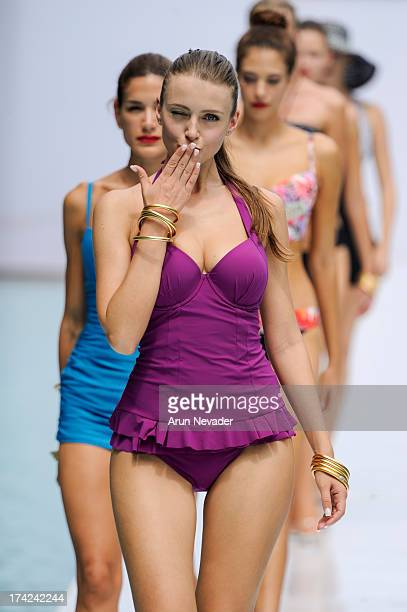 Models walk the runway during finale at the Profile by Gottex fashion show at MercedesBenz Fashion Week Swim 2014 Runway at SLS Hotel on July 21 2013...