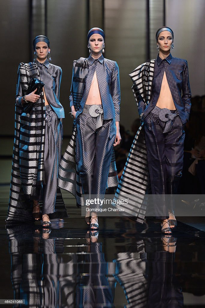 Models walk the runway during Giorgio Armani Prive show as part of Paris Fashion Week Haute Couture Spring/Summer 2014 on January 21, 2014 in Paris, France.