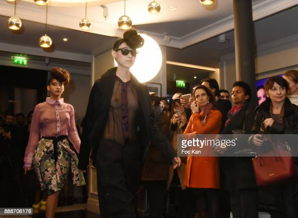 Models walk the runway during Ken Okada Fashion Show at Hotel W on December 8 2017 in Paris France