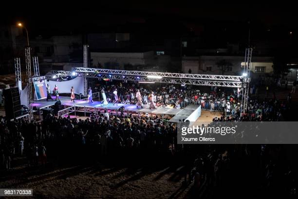 Models walk the runway during Nansaly show at the last day of the Dakar Fashion Week at the working class suburb of Keur Massar on June 24 2018 in...