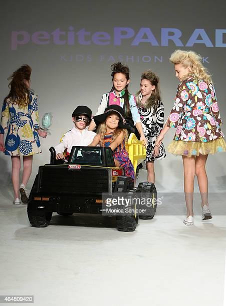Models walk the runway during petitePARADE / Kids Fashion Week at Bathhouse Studios on February 28 2015 in New York City