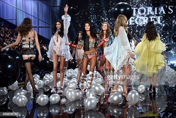 Models walk the runway during the 2014 Victoria's Secret Fashion Show at Earl's Court exhibition centre in London on December 2, 2014. AFP PHOTO /...