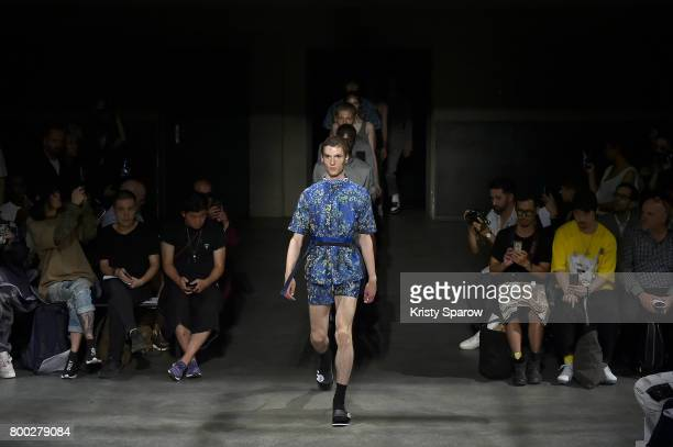 Models walk the runway during the 22/4_Hommes Menswear Spring/Summer 2018 show as part of Paris Fashion Week on June 23 2017 in Paris France