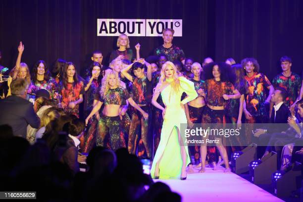 Models walk the runway during the About You fashion show during the AYFW - About You Fashion Week at ewerk on July 07, 2019 in Berlin, Germany.