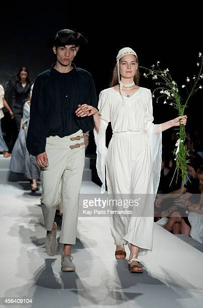 Models walk the runway during the Agnes B show as part of the Paris Fashion Week Womenswear Spring/Summer 2015 on September 30 2014 in Paris France