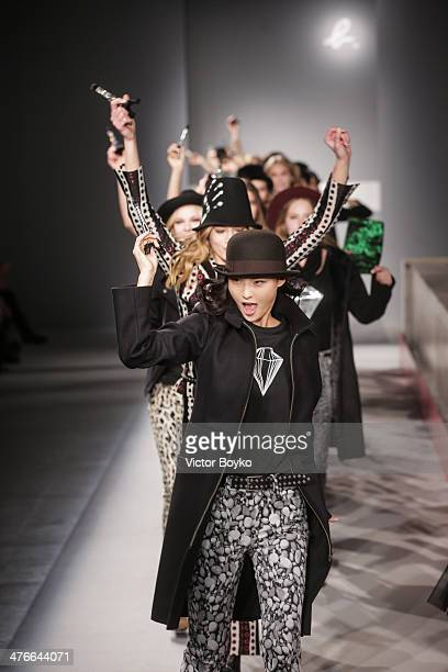Models walk the runway during the Agnes B show as part of the Paris Fashion Week Womenswear Fall/Winter 20142015 on March 4 2014 in Paris France