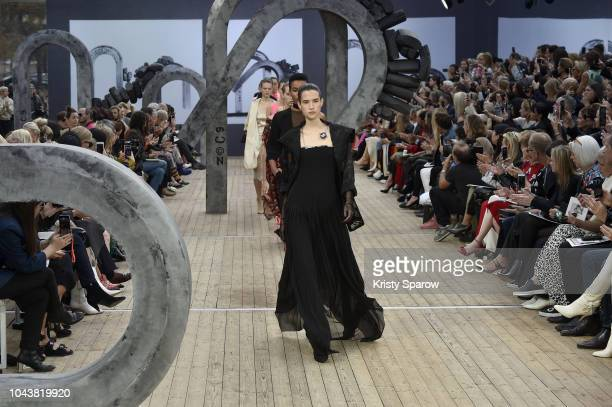Models walk the runway during the Akris show as part of Paris Fashion Week Womenswear Spring/Summer 2019 on September 30, 2018 in Paris, France.