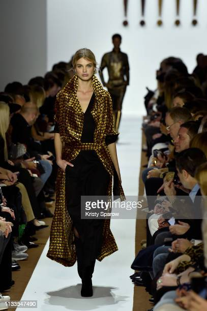 Models walk the runway during the Akris show as part of Paris Fashion Week Womenswear Fall/Winter 2019/2020 on March 03, 2019 in Paris, France.