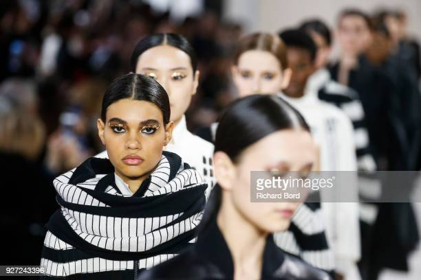 Models walk the runway during the Akris show as part of the Paris Fashion Week Womenswear Fall/Winter 2018/2019 on March 4 2018 in Paris France