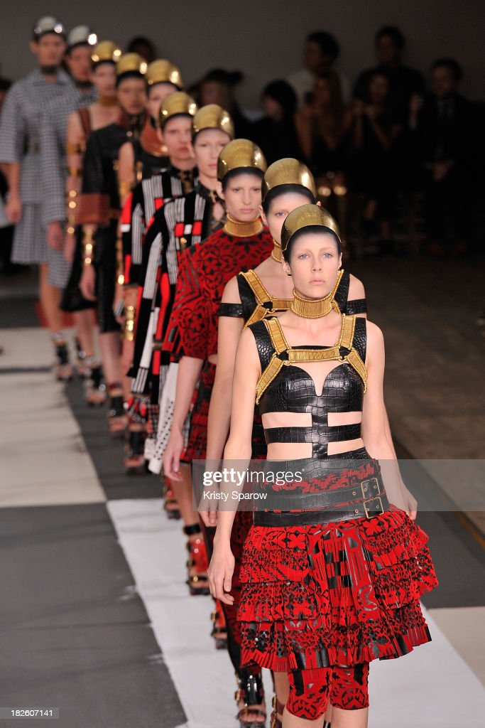 Models walk the runway during the Alexander McQueen show as part of Paris Fashion Week Womenswear Spring/Summer 2014 on October 1, 2013 in Paris, France.