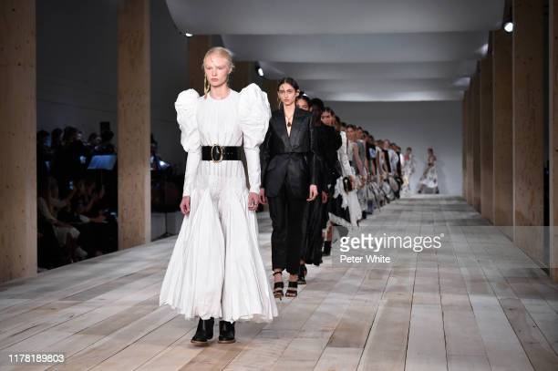 Models walk the runway during the Alexander McQueen Womenswear Spring/Summer 2020 show as part of Paris Fashion Week on September 30, 2019 in Paris,...