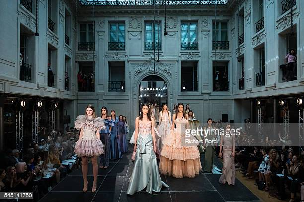 Models walk the runway during the Alexis Mabille Haute Couture Fall/Winter 20162017 show as part of Paris Fashion Week on July 5 2016 in Paris France