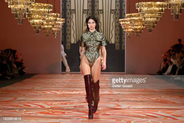 Models walk the runway during the Alice McCall show during Afterpay Australian Fashion Week 2021 Resort '22 Collections at Carriageworks on May 31,...