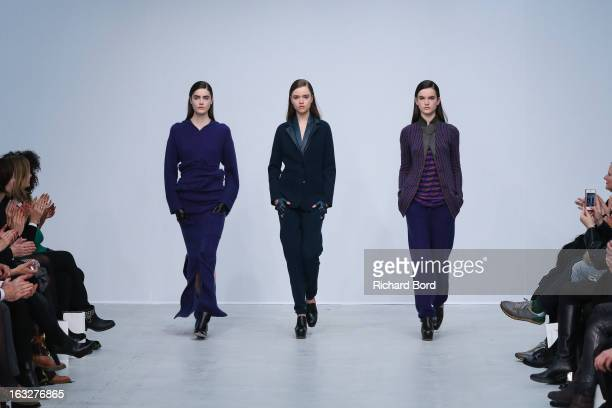 Models walk the runway during the Allude Fall/Winter 2013 ReadytoWear show as part of Paris Fashion Week at Palais de Tokyo on March 6 2013 in Paris...