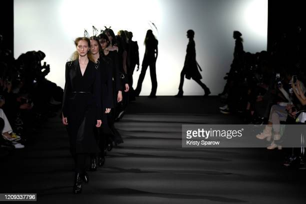 Models walk the runway during the Ann Demeulemeester show as part of Paris Fashion Week Womenswear Fall/Winter 2020/2021 on February 27, 2020 in...