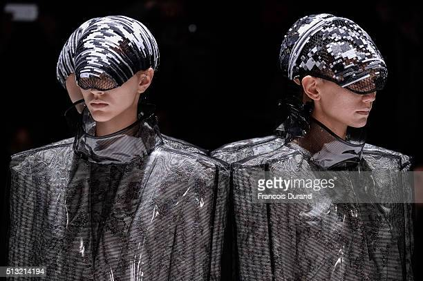 Models walk the runway during the Anrealage show as part of the Paris Fashion Week Womenswear Fall/Winter 2016/2017 on March 1 2016 in Paris France