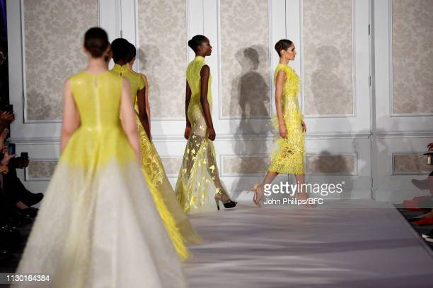 Models walk the runway during the Atelier Zuhra show mansion soirèe event during London Fashion Week February 2019 at the on February 16 2019 in...