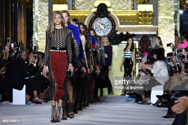 Models walk the runway during the Balmain show as part of the Paris Fashion Week Womenswear Spring/Summer 2018 on September 28 2017 in Paris France