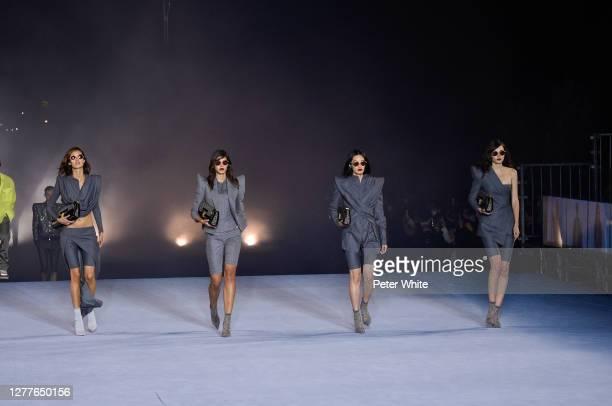 Models walk the runway during the Balmain Womenswear Spring/Summer 2021 show as part of Paris Fashion Week on September 30, 2020 in Paris, France.