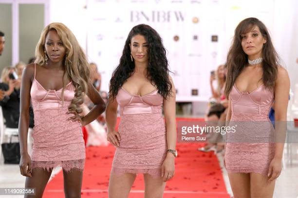 Models walk the runway during the BeautyNtheBox show at BNTB Cannes Fashion Week on May 14 2019 in Cannes France