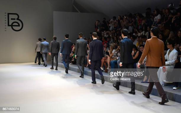 Models walk the runway during the Behnoode Menswear show at Fashion Forward October 2017 held at the Dubai Design District on October 28, 2017 in...