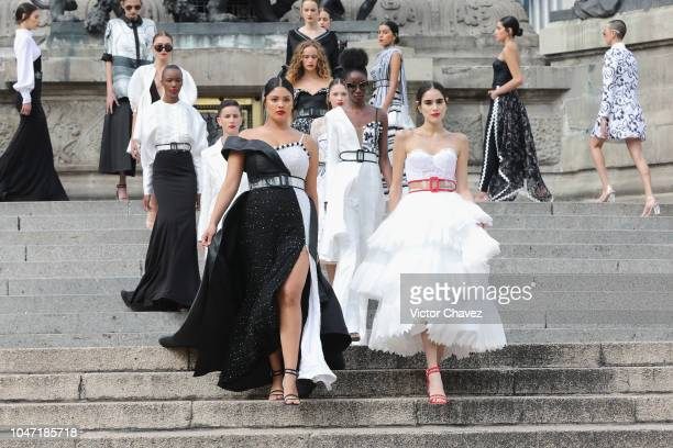 Models walk the runway during the Benito Santos at Mercedes Benz Fashion Week Mexico at Angel De La Independencia on October 7 2018 in Mexico City...