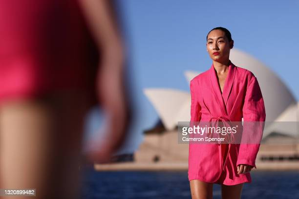 Models walk the runway during the BONDI BORN show during Afterpay Australian Fashion Week 2021 Resort '22 Collections at the Northern Wharf...