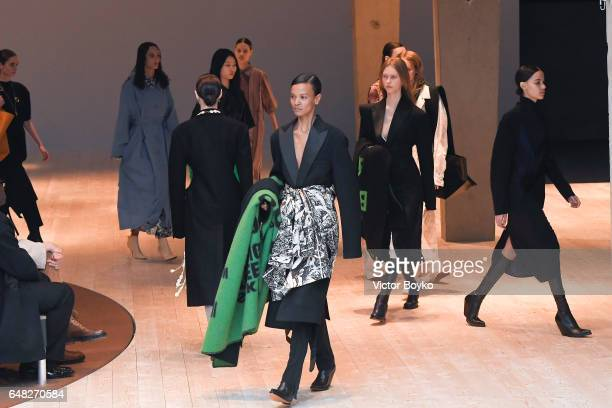 Models walk the runway during the Celine show as part of the Paris Fashion Week Womenswear Fall/Winter 2017/2018 on March 5 2017 in Paris France