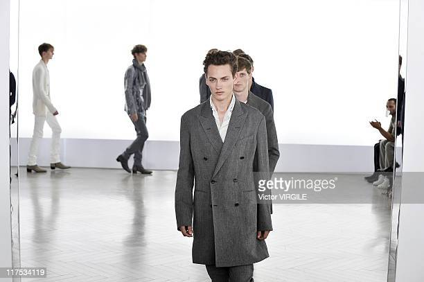 Models walk the runway during the Cerruti Ready to Wear Spring/Summer 2012 show as part of the Paris Men Fashion Week on June 25 2011