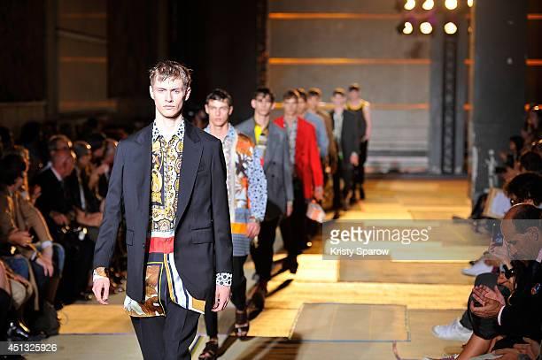 Models walk the runway during the Cerruti show as part of Paris Fashion Week Menswear Spring/Summer 2015 on June 27 2014 in Paris France