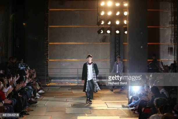Models walk the runway during the Cerruti show as part of the Paris Fashion Week Menswear Spring/Summer 2015 at Espace Vendome on June 27 2014 in...