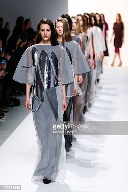 Models walk the runway during the Chalayan show as part of the Paris Fashion Week Womenswear Fall/Winter 2014-2015 at Les Beaux Arts on February 28,...