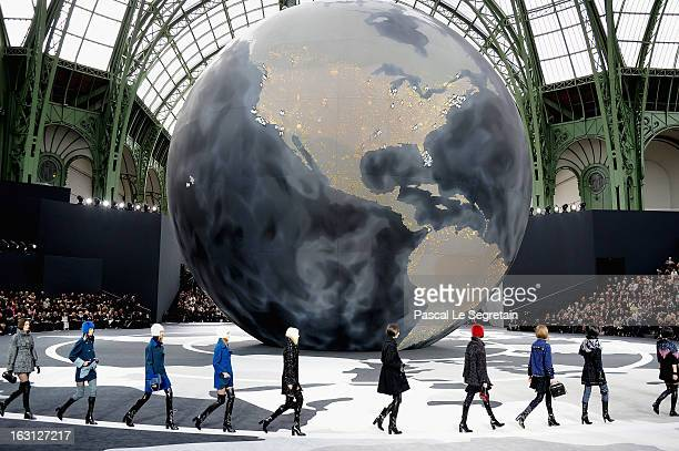 Models walk the runway during the Chanel Fall/Winter 2013 ReadytoWear show as part of Paris Fashion Week at Grand Palais on March 5 2013 in Paris...