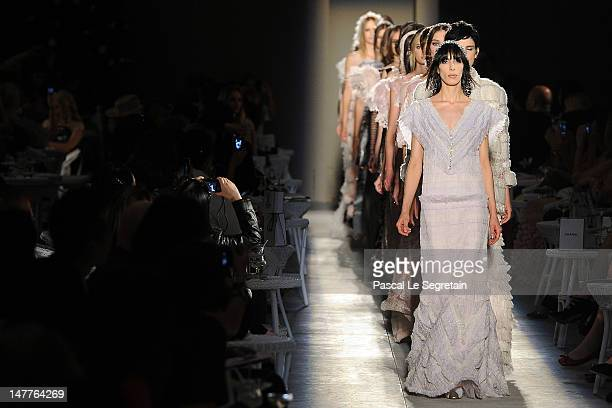 Models walk the runway during the Chanel HauteCouture show as part of Paris Fashion Week Fall / Winter 2012/13 at the Grand Palais on July 3 2012 in...