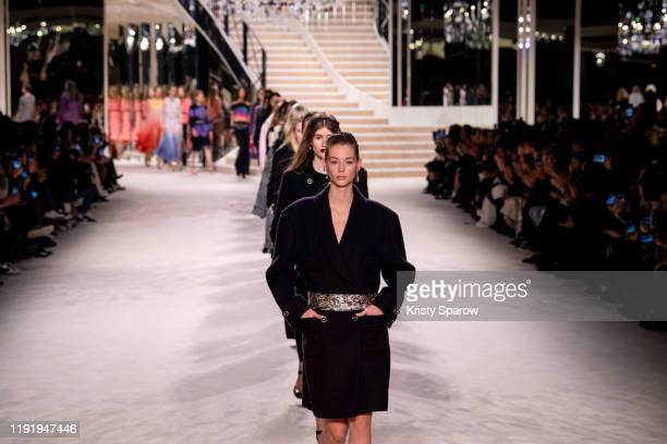Models walk the runway during the Chanel Metiers d'Art 2019-2020 show finale at Le Grand Palais on December 04, 2019 in Paris, France.