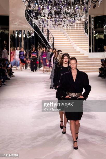 Models walk the runway during the Chanel Metiers d'Art 20192020 show finale at Le Grand Palais on December 04 2019 in Paris France