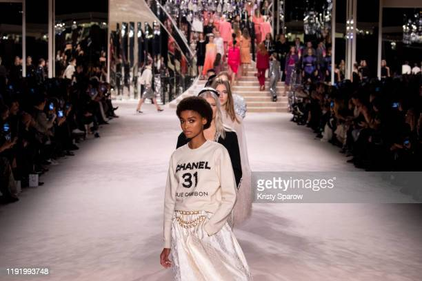Models walk the runway during the Chanel Metiers d'Art 2019-2020 show at Le Grand Palais on December 04, 2019 in Paris, France.
