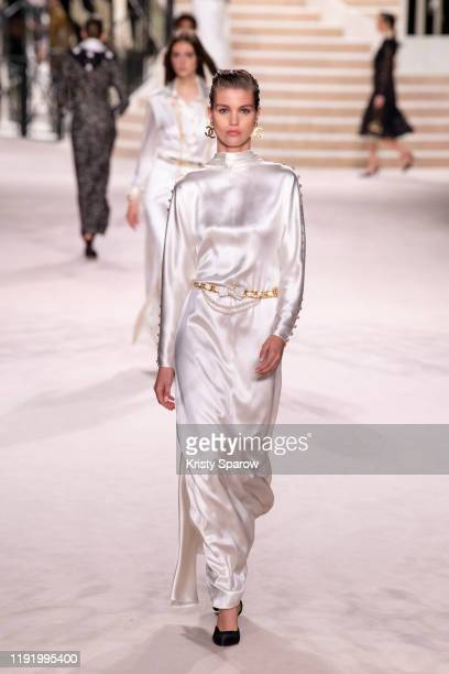 Models walk the runway during the Chanel Metiers d'Art 20192020 show at Le Grand Palais on December 04 2019 in Paris France