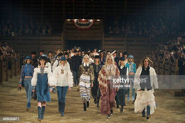 Models walk the runway during the Chanel Metiers d'Art Show at Fair Park on December 10 2013 in Dallas Texas