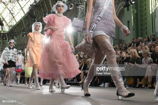 Models walk the runway during the Chanel Paris show as part of the Paris Fashion Week Womenswear Spring/Summer 2018 on October 3 2017 in Paris France