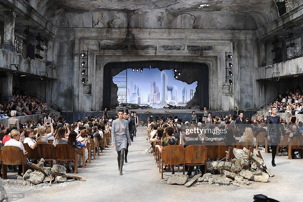 Models walk the runway during the Chanel show as part of Paris Fashion Week Haute-Couture Fall/Winter 2013-2014 at Grand Palais on July 2, 2013 in Paris, France.