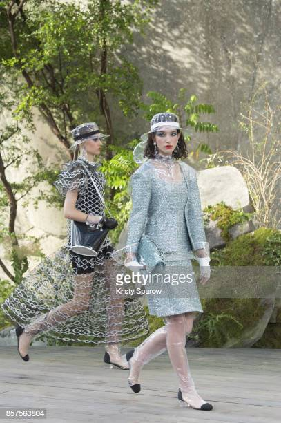 Models walk the runway during the Chanel show as part of Paris Fashion Week Womenswear Spring/Summer 2018 on October 3 2017 in Paris France