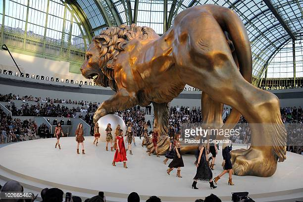 Models walk the runway during the Chanel show as part of the Paris Haute Couture Fashion Week Fall/Winter 2011 at Grand Palais on July 6, 2010 in...